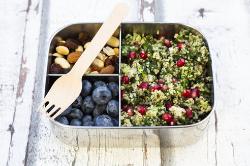 Lunchbox with bulgur herbs salad with pomegranate seeds, taboule, blueberries and trail mIx - LVF07973