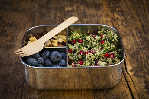 Lunchbox with bulgur herbs salad with pomegranate seeds, taboule, blueberries and trail mIx - LVF07976