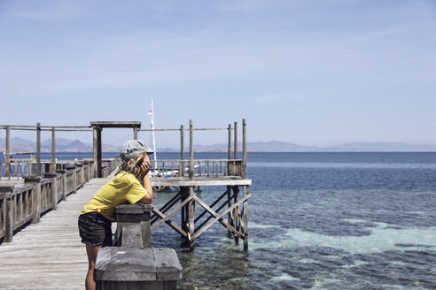 Indonesia, Komodo National Park, girl on a jetty looking out - MCF00130