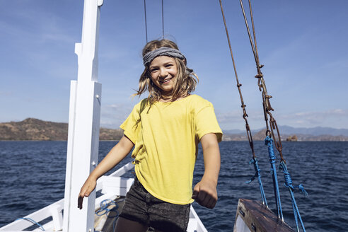 Indonesia, Komodo National Park, portrait of happy girl on a sailing boat - MCF00133