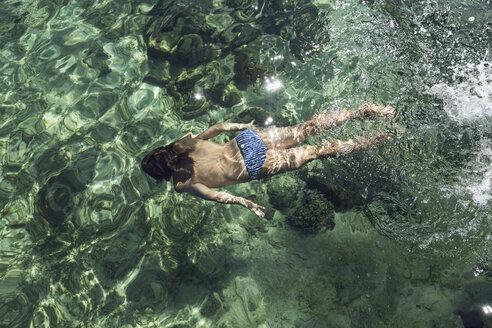Indonesia, Komodo National Park, girl swimming in the sea - MCF00142