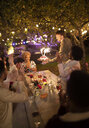 Friends celebrating birthday with sparkler cake at garden party - CAIF23218