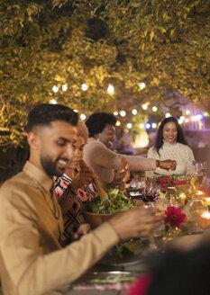 Friends enjoying dinner garden party - CAIF23227