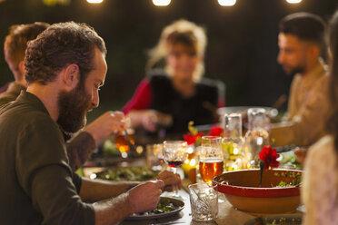 Friends enjoying dinner garden party - CAIF23236
