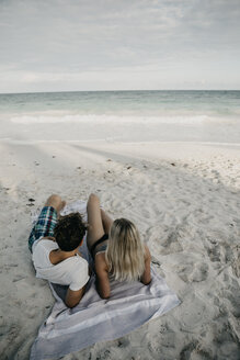 Mexico, Quintana Roo, Tulum, couple lying on the beach looking at view - LHPF00681