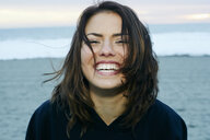 Portrait of laughing Caucasian woman at beach - BLEF00261