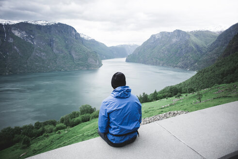 Caucasian man admiring scenic view of river - BLEF00297
