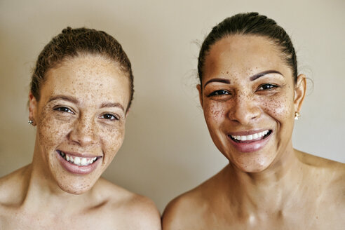 Close up of smiling mixed race women - BLEF00408