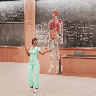 Teacher looking at organs of transparent hologram man - BLEF00648