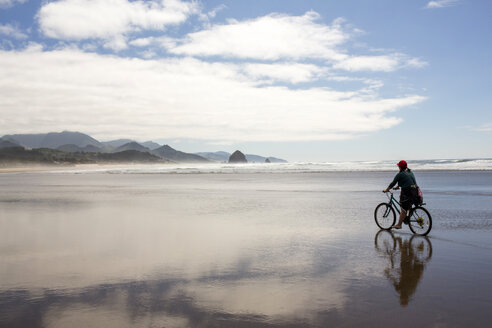 Caucasian woman riding bicycle on beach - BLEF00774
