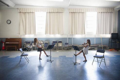Caucasian girls practicing violins and dancing - BLEF00786