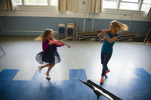 Caucasian girls practicing violins and dancing - BLEF00789