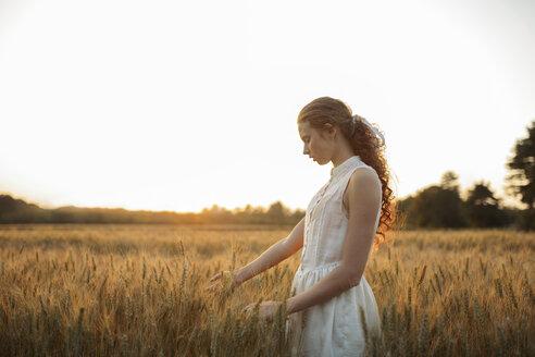 Caucasian girl standing in field of wheat - BLEF00930