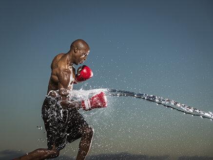 Water splashing on black boxer punching - BLEF01026