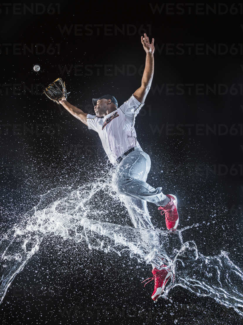 Water Splashing On Jumping Black Baseball Player Blef01035 Erik Isakson Westend61