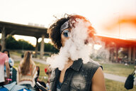 Close-up portrait of man smoking at music festival - MASF12058