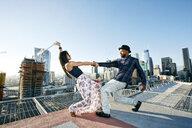 Couple dancing on urban rooftop - BLEF01333