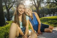 Portrait of smiling Caucasian girls on blanket in park - BLEF01411