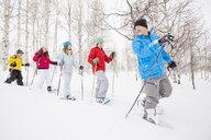 Caucasian family snowshoeing in winter - BLEF01672