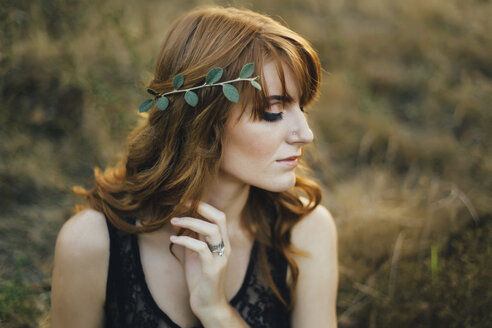 Pensive Caucasian woman with leaves in hair - BLEF01714