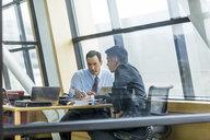Businessmen talking in meeting - BLEF01735