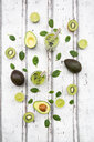 Two glasses of green smoothie with avocado, spinach, kiwi and lime - LVF07994