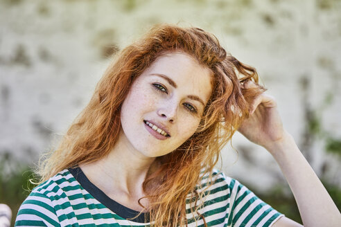 Portrait of redheaded young woman with freckles - FMKF05667