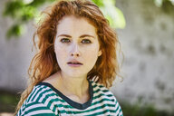 Portrait of redheaded young woman with freckles - FMKF05670