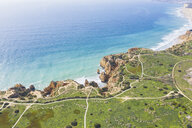 Portugal, Algarve, Lagos, Ponta da Piedade, aerial view of rocky coastline and sea - MMAF00920