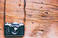 Camera and strap on wooden table - BLEF02053