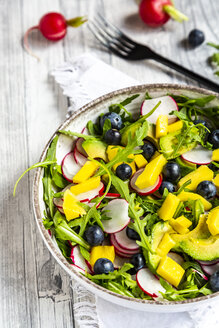 Bowl of rocket salad with mango, avocado, red radishes and blueberries - SARF04249