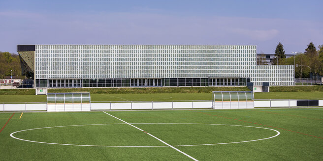 Germany, Tuebingen, modern Multi-Purpose Hall Paul Horn-Arena with solar panels and football pitch - WDF05257