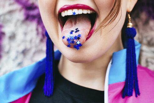 1980s retro-styled woman with stars on tongue - JUBF00349