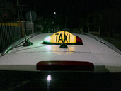 Light taxi sign on a street in romania. Cluj-Napoca, Romania. - OCMF00439