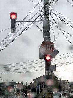 The rain falls on a car windshield at a traffic light. Cluj-Napoca, Romania. - OCMF00442
