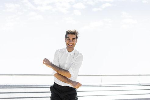 Portrait of happy businessman outdoors - AFVF02923