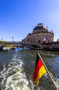 Germany, Berlin, Bode Museum and German flag on excursion boat on River Spree - PUF01417