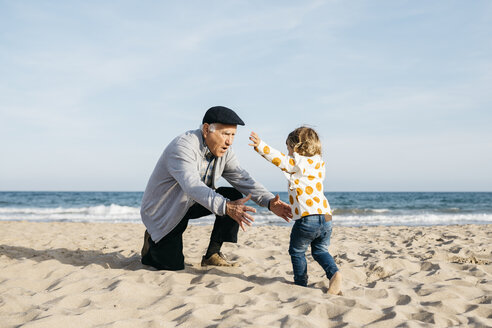 Grandfather playing with his granddaughter on the beach - JRFF03214