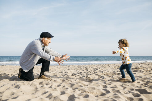 Grandfather playing with his granddaughter on the beach - JRFF03217