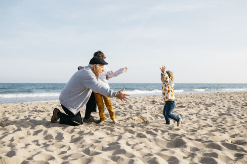 Grandfather playing with his grandchildren on the beach in spring - JRFF03223