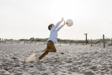Little boy playing soccer on the beach - JRFF03235