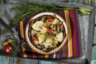 Casserole with aubergines, tomatoes, potatoes and green olives garnished with dill - MAEF12863