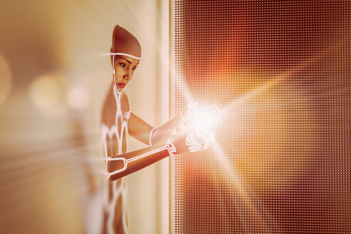 Light glowing in hands of futuristic woman emerging from wall - BLEF02436