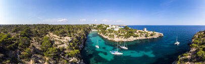 Spain, Balearic Islands, Mallorca, Llucmajor, Aerial view of bay of Cala Pi and Torre de Cala Pi - AMF06981