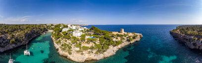 Spain, Balearic Islands, Mallorca, Llucmajor, Aerial view of bay of Cala Pi and Torre de Cala Pi - AMF06984