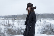 Serious Caucasian woman wearing fur hat and coat in winter - BLEF02606