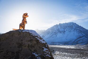 Dinosaur statue on rock - BLEF02729