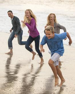 Smiling family running on beach - BLEF02804