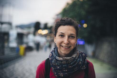Portrait of smiling Caucasian woman wearing scarf - BLEF02837