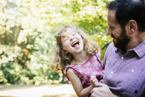 Caucasian father carrying laughing, daughter - BLEF02873